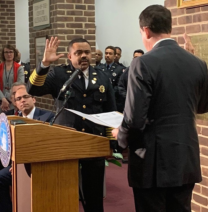 Alexandria Fire Chief Corey Smedley is sworn in by Circuit Court Clerk Greg Parks during a Jan. 28 ceremony at City Hall. Smedley was named to the role in December, becoming the city's first African American Fire Chief.