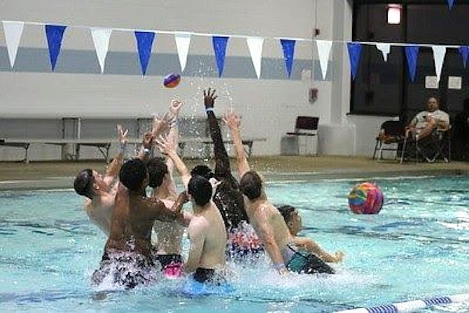 Playing football in the pool on graduation night is a part of the all-night graduation parties, which don't happen without fundraising.