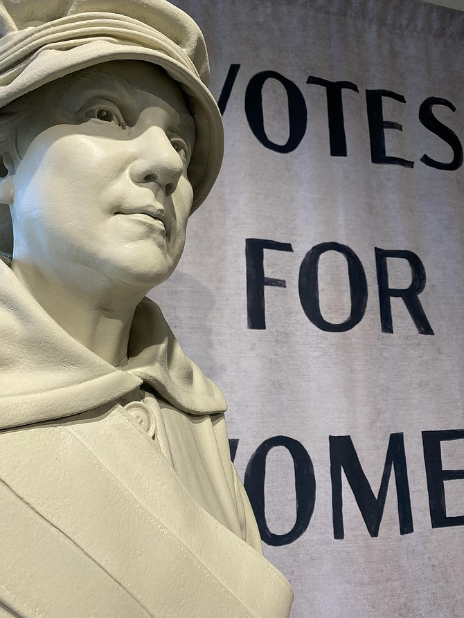 Larger-than-life statue of Lucy Burns, a prominent leader in the fight for women's voting rights.