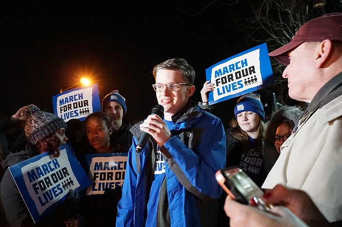Robinson High School senior Michael McCabe, 17, tells fellow activists gathered Jan. 20 at a candlelight vigil in front of the National Rifle Association in Fairfax about the sense of urgency he and his peers feel about gun violence.