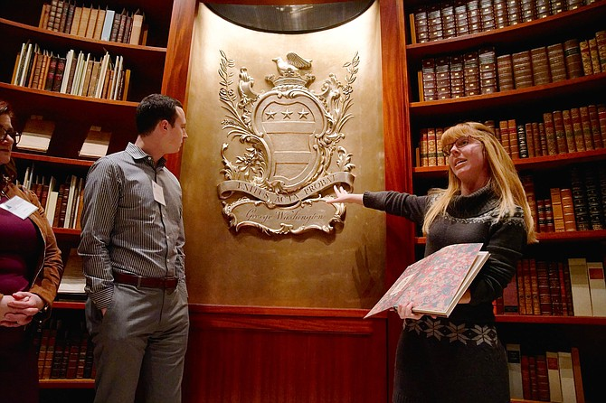 Clare Moore, right, gives attendees a tour of the vault, which holds Washington's books and rare manuscripts, during The Leadership Collection at Alexandria launch event Jan. 16 at the Fred W. Smith National Library for the Study of George Washington at Mount Vernon.
