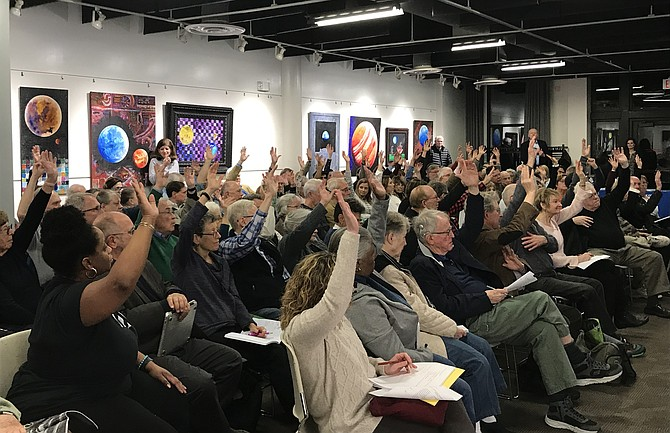 A show of hands indicates that nearly all attendees at the Hunter Mill District Supervisor Town Hall Meeting, hosted by Supervisor Walter Alcorn (D-Hunter Mill), live in Reston.