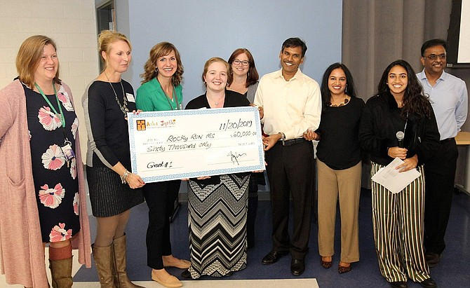 Rocky Run Principal Amy Goodloe (second from left) and her staff with a $60,000 check from Asha-Jyothi.