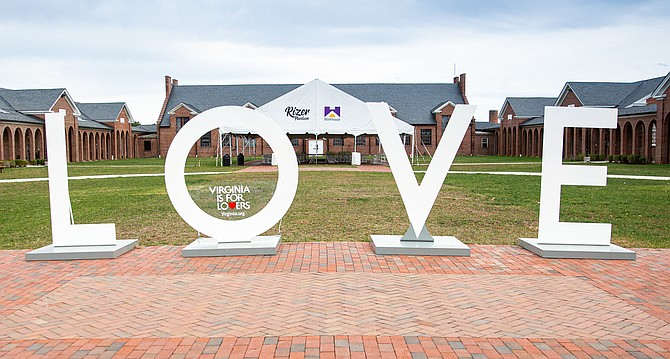 The LOVEworks sign, permanently located at the Workhouse Arts Center, has undergone an artistic transformation and will be unveiled Friday, Feb. 14, 2020 at 10 a.m.
