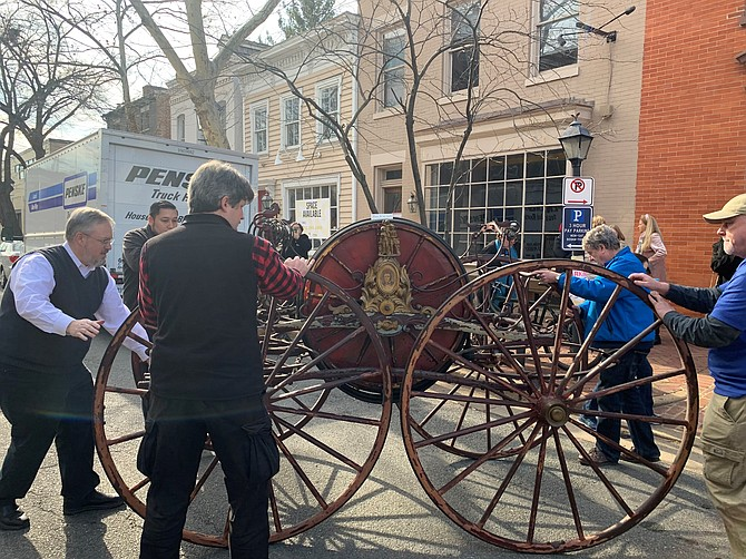 The 1858 Prettyman Hose Carriage is removed from the Friendship Firehouse Museum Feb. 1 in preparation for conservation work to restore the historic fire fighting apparatus.