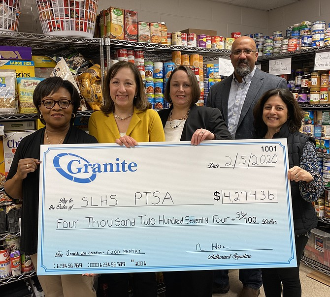 From left: Lucretia Mattar, Senior Financial Analyst and Lisa Martin, Administrative Assistant at the Greensboro Drive, Tysons Corner office of Granite Telecommunications, present a $4,500 donation check on behalf of the company to the South Lakes High School (SLHS) Parent Teacher Student Association (PTSA) Food Pantry on Feb. 2. Present to receive the donation is South Lakes High School Principal Kim Retzer, Paul D. Thomas, SLHS PTSA President and Roberta Gosling, SLHS Pantry Co-Founder.