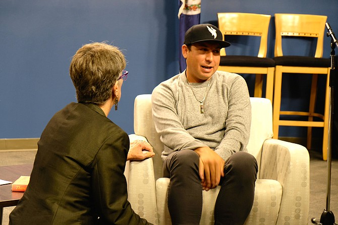 "Tommy Orange, author of the book, ""There There"" speaks with Head Librarian, Diane Kresh, at the ""Arlington Reads"" talk.  Kresh gave Orange the opening he needed to share his background and his struggle to retain his tribal identity."