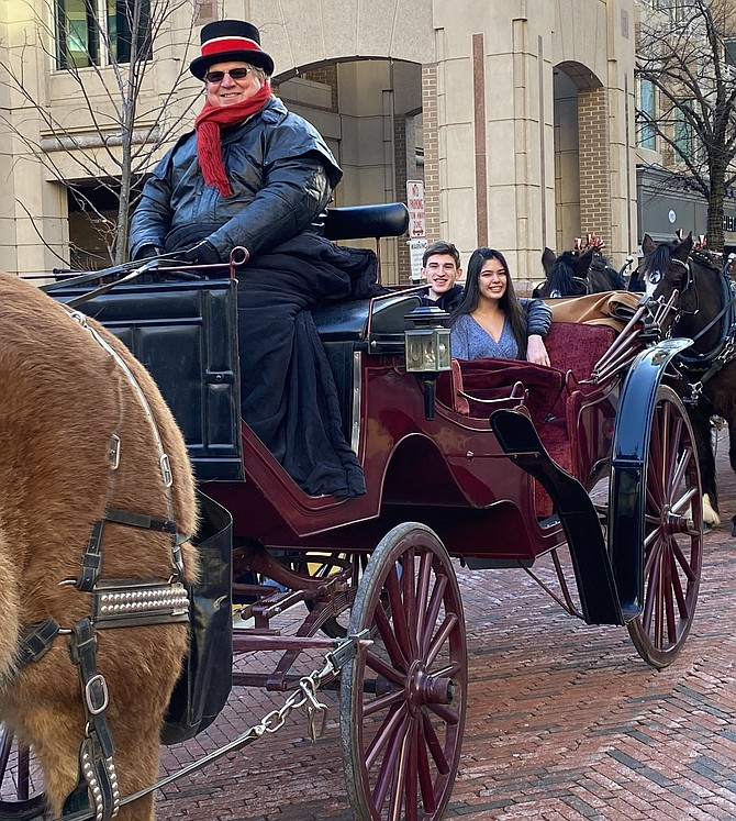Chloe Richmond and Brendan Miers of Chantilly prepare for a romantic tour of Reston Town Center in a horse-drawn carriage on Valentine's Day.