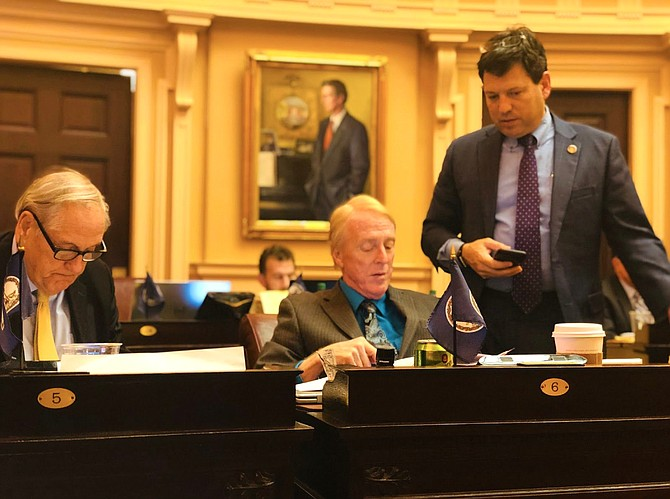 Sen. Scott Surovell (D-36), right, introduced an amendment on the Senate floor to take a regional approach to the minimum wage. That's an idea originally proposed by Sen. David Marsden (D-37), whose vote Surovell was trying to get by introducing the amendment.