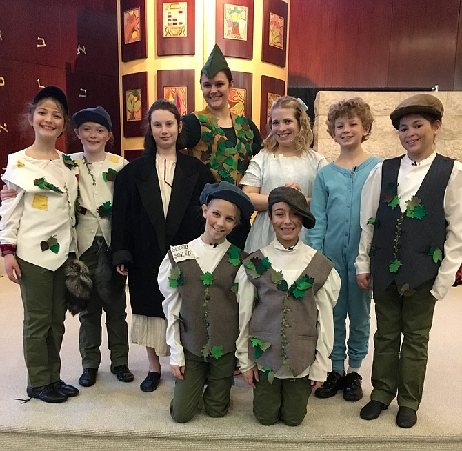 Peter Pan and Wendy pose with the Darling children and the Lost Boys  during dress rehearsal Sunday. Kneeling are Ella Fielding and Sydney Martin. Standing from left are Eden Shaw, Jackie Williams, Sari Gabel, Laura Searles, Jessie Dugan, Samuel Friel and Liat Topolosky.