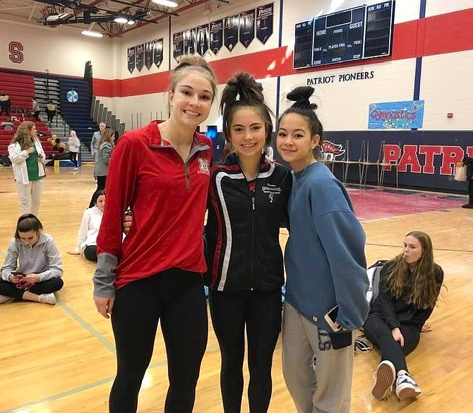 From left: Tara Stewart (Senior, McLean HS); Kerry Gallagher (Senior, Herndon High) and Grace Chen (Sophomore, Washington & Liberty High, Arlington) at the gymnastics State Championship last Saturday, Feb. 22.
