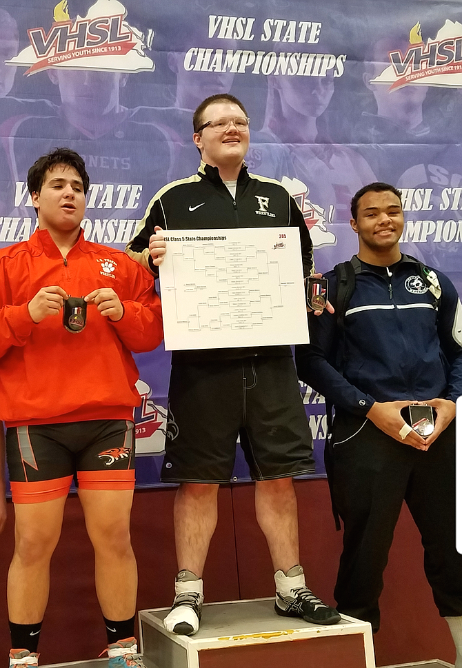 Caleb O'Cain of  Great Falls, right, won third place at the State Championship held at Rock Ridge High School in Ashburn.