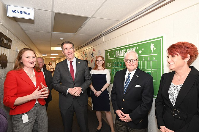Virginia Gov. Ralph Northam, second from left, is shown with Volunteer Fairfax Chief Operating Officer Emily Swenson, left, Volunteer Fairfax Board of Directors President  Ginger L. Bristow, center, Volunteer Fairfax Chief Executive Officer Steve Mutty,second from right,  and RSVP-Northern Virginia Program Manager Brandi Morris, during the governor's visit to Volunteer Fairfax.  Tuesday, Feb. 25, 2020, in the City of Fairfax.