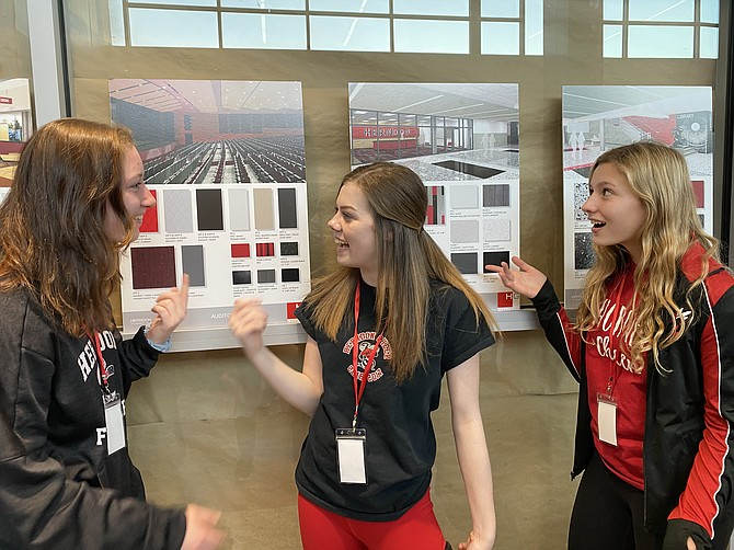 From left, Herndon Hornets: Cailley Graham, 15, of Herndon, Hannah Clements, 16, of Reston and Kate LaRosa, 16, of Reston take note of three renderings depicting plans of different renovations/additions for their school.