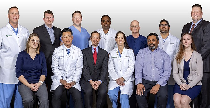 The Reston Hospital Center Trauma II team (front row, from left): Frances Hughes RN; Dr. Jae Lim; Dr. Peter Dougherty; Dr. Mary Boggs; Dr. Ranjit Pullarkat; Jessica Fuerstinger; (back row, from left): Dr. Brad Ryan; Dr. Brett Sachse; Lyle Ritch, PA; Dr. Anil Maliyekkel; Luther Surface, RN; Ruben Perez, NP; Dallas Taylor, RN.
