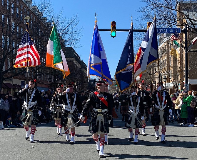 The St. Andrew's Society of Washington color guard walks past the reviewing stand during the March 7 St. Patrick's Day Parade in Old Town.