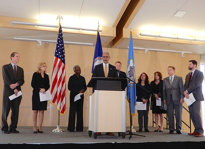 State Health Commissioner Oliver at the podium. (From left) are Dr. Ben Schwartz, Dr. Lilian Peake, Dr. Gloria Addo-Ayensu, Dr. Norm Oliver, Jeff McKay, Dr. Denise Toney, Dr. Alison Ansher, David Meyer and John Silcox.
