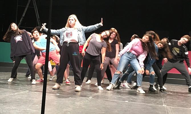 Sasha Alekseyeba and ensemble rehearse for BLAST at Churchill High School Friday.