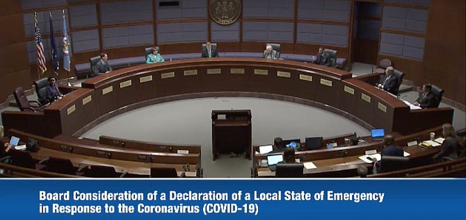 Sitting six feet apart, Fairfax County Board of Supervisors considers and unanimously approves a resolution of a Declaration of Local Emergency Management effective immediately, March 17, 2020, in response to the coronavirus (COVID-19).