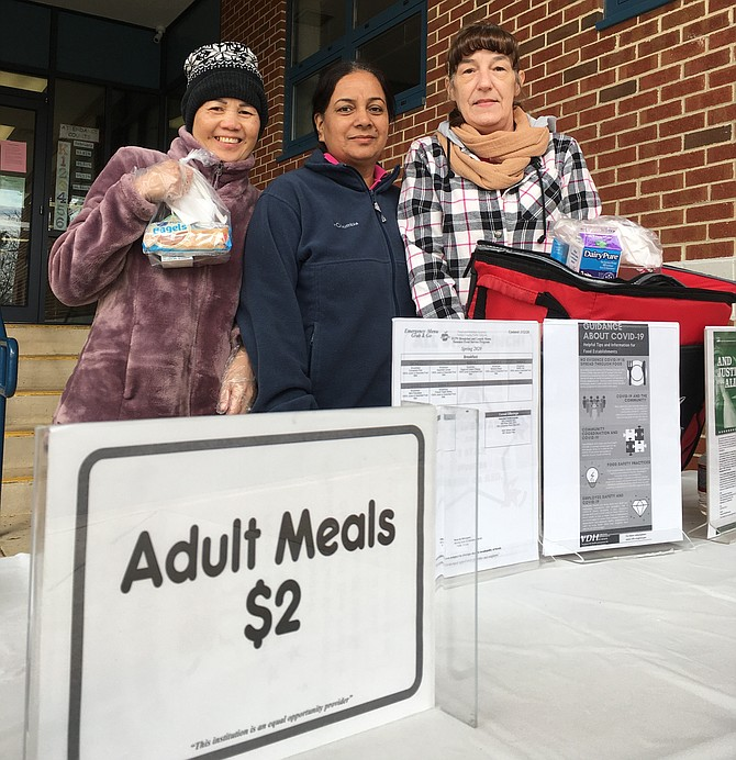 At Crestwood Elementary School in Springfield, Wednesday, March 18: Ketsana Phonemany, Ginger Swiger and Juz Kaur handed out free breakfast to area students.