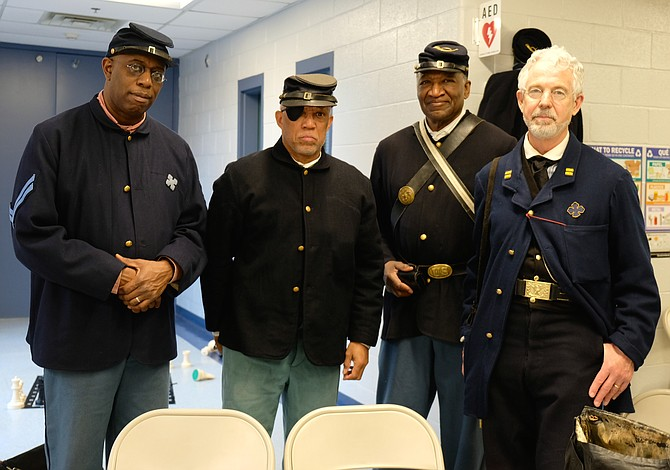 Bryan Cheeseboro (left) and friends dressed in uniforms appropriate for the 54th Massachusetts Volunteer Infantry, Company 'B', telling the story of the freed African Americans who fought for the Union Army. For more information, see: www.54thmass.org