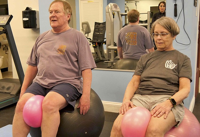 "Cynthia and Jeremy balance on large balls. ""It's harder than you think."""