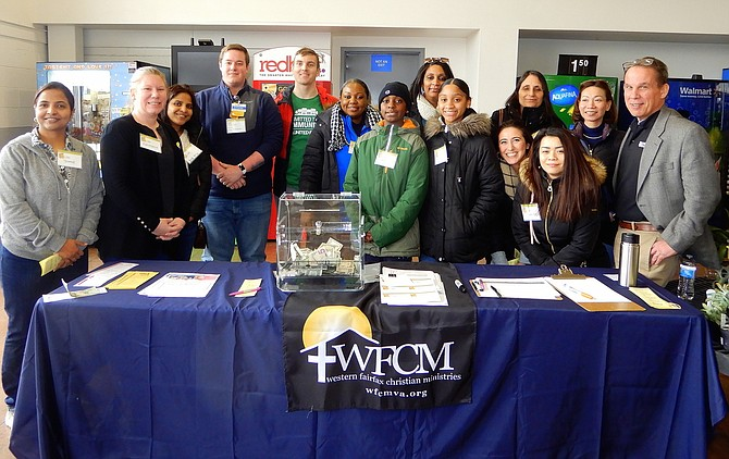 WFCM Executive Director Harmonie Taddeo (second from left) with county, community and business volunteers during the Feb. 29 Stuff the Bus event.
