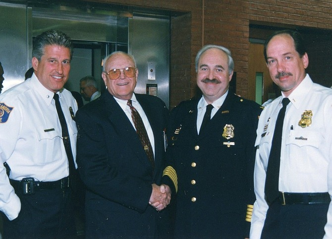 Former Alexandria Chief of Police Charles Samarra, second from right, died March 17 following a three-month battle with a brain tumor. He was 74.
