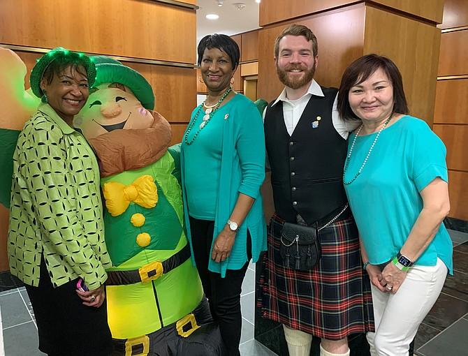 Dr. Elisabeth Palmer-Johnson, Marian Pegram and Paul Kentes get in the Irish spirit at the second annual Sips For Saints fundraiser sponsored by the Alexandria Central Rotary Club March 13 at The Atrium.