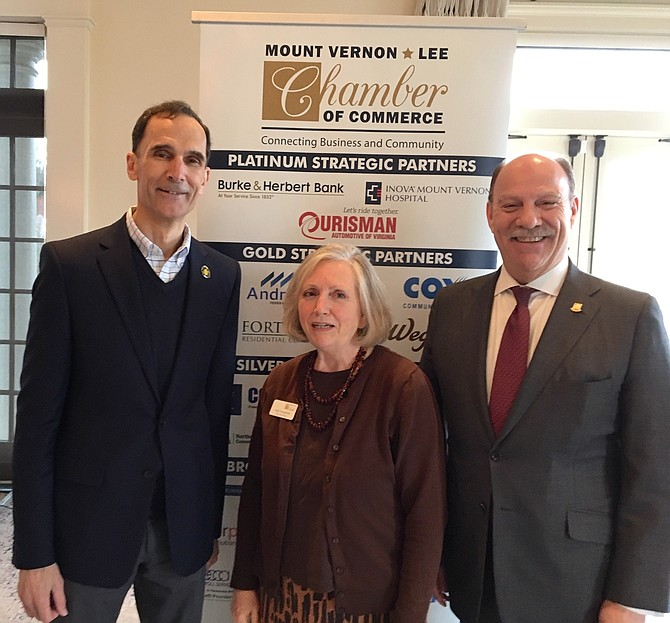 Holly Dougherty (center) Chamber Executive Director, welcomes Supervisor Dan Stork (left) and Barry Biggar, Visit Fairfax (right) to the Chamber's March Business Breakfast.