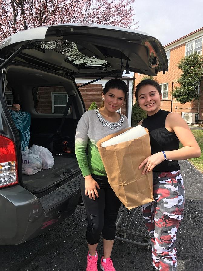 Wendy Rebera and Jenna Amendez load the car at Koinonia in Franconia.