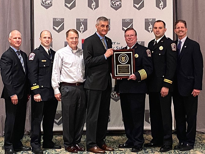 (From left) are Chief Ralph Ensign, CFAI peer team leader (Ret. Chief, Glenview, Ill.); Capt. Brian Orndoff, Fairfax City Fire Dept. EMS officer; Fairfax Mayor David Meyer; Chief Steve Dongworth, CFAI chair, (Calgary, Canada); City Fire Chief John O'Neal; Capt. Shawn Dunstan, Fairfax City Fire Dept. accreditation manager; and City Manager Rob Stalzer.