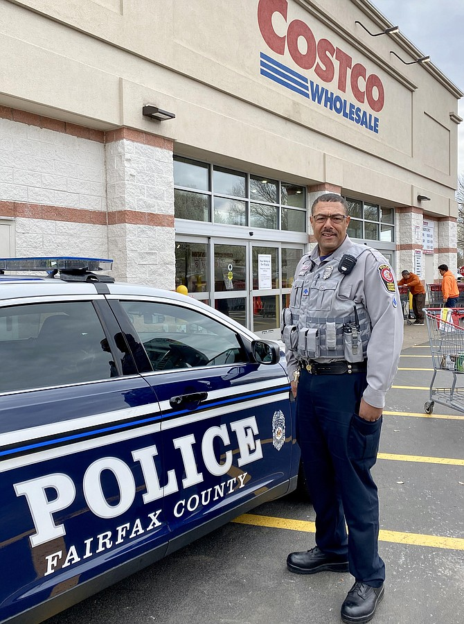 Police Officer R. Morton stationed at Costco as a crowd control precaution.