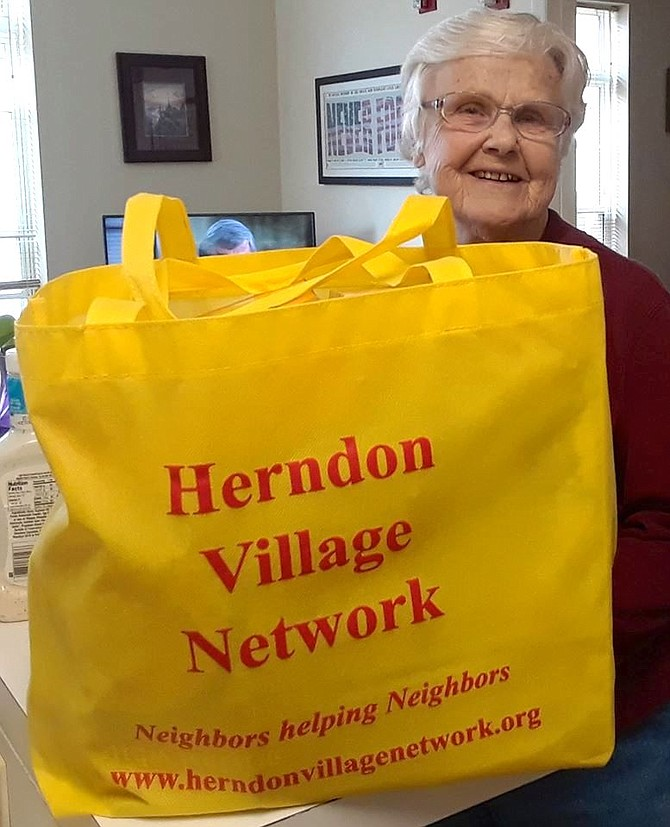 Judy Ferris, a resident of Herndon Harbor House, thanks Herndon Village Network for helpful shelf-stable foods.