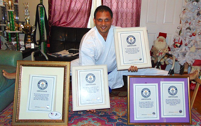 Guinness World Record holder Ujjwal Sharma Thakuri of Springfield with his five world record certificates.