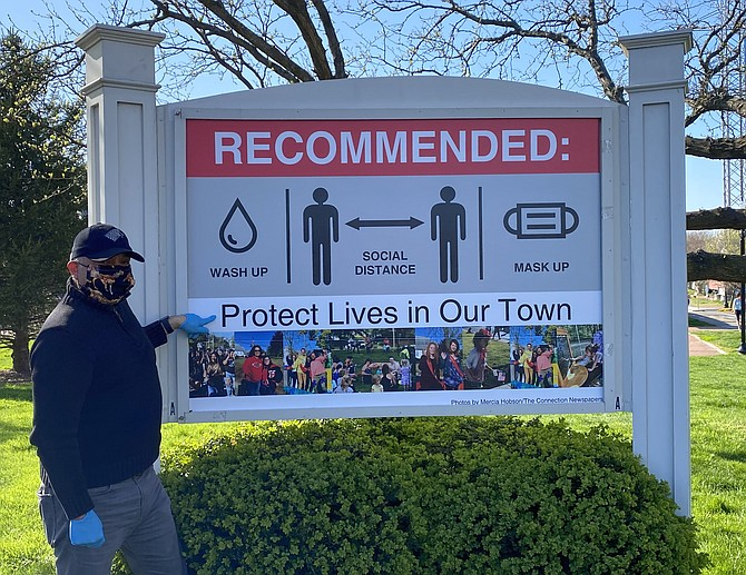 "Herndon Town Councilmember Cesar del Aguila installed the sign at no cost on the Town Square based on Fairfax County's and Commonwealth of Virginia's recommendations to stop the spread of COVID-19. ""Protect Lives in Our Town."""