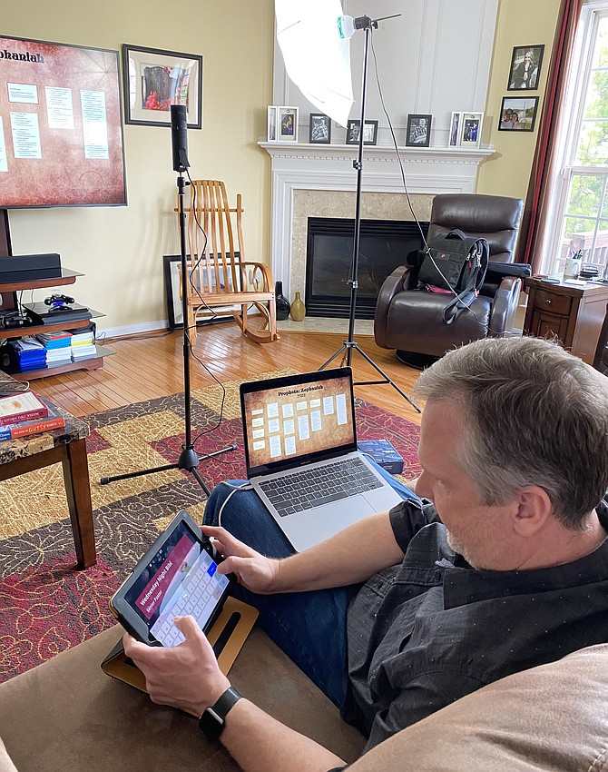Senior Pastor Robert Wallace prepares for a streamed Wednesday night Bible study from his house for the Mclean Baptist Church congregation.