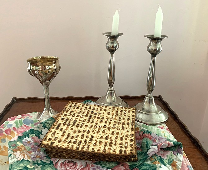 Elijah's Cup, candlesticks to be lit and matzah are part of the traditional Passover Seder dinner.