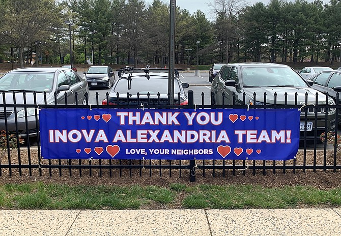 A sign of thanks hangs outside Inova Alexandria Hospital. Local residents had the sign made to show their appreciation for those working during the COVID-19 pandemic.