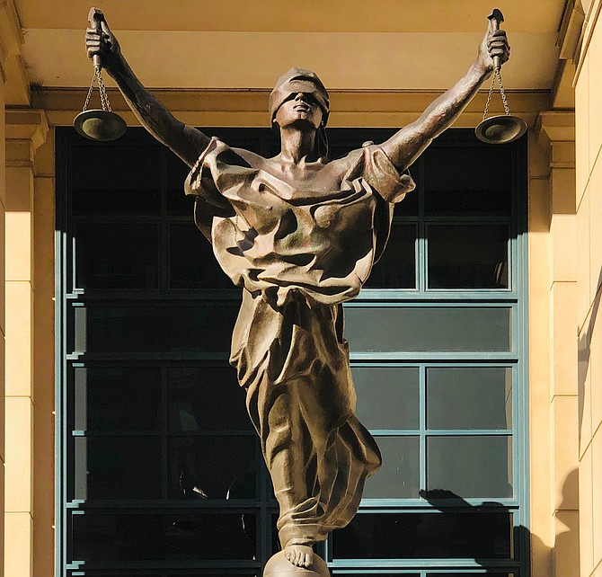 """The title of the famous statue at the Albert Bryan U.S. Courthouse in Alexandria is """"Justice Delayed, Justice Denied."""""""