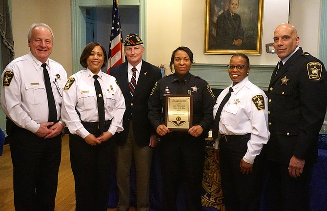 Alexandria Sheriff's Office Deputy Ashley Battle, third from right, poses for a photo after being presented with the Law Enforcement Officer of the Year Award March 11 at the American Legion Post 24. Joining Battle are (l-r): Sheriff Dana Lawhorne, Captain Lynn Oliver, Post 24 Commander Henry Dorton, Chief Deputy Candra Callicott and Sergeant Gregory Perez.