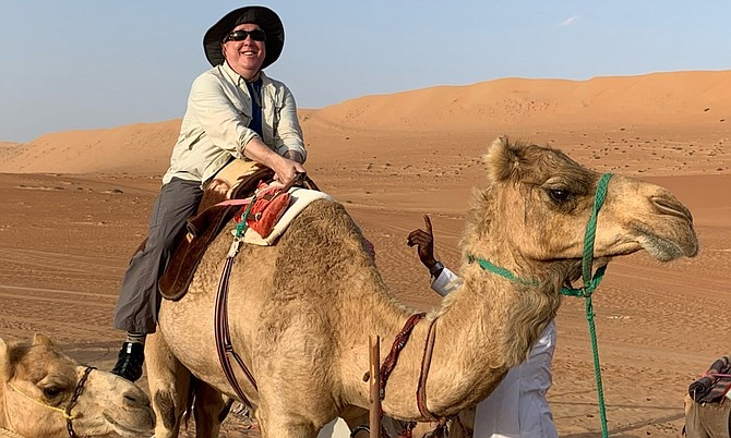 Brian Miller atop a camel during one of his many travel adventures. He visited 45 states and 65 countries.