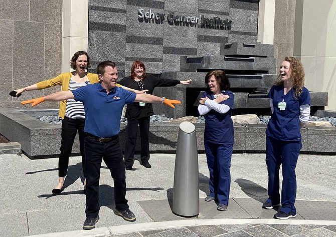 Chantilly's Matt Curry does social distancing from nurses outside the Schar Cancer Institute after a meal delivery there.