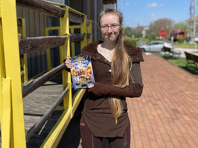 """Leah Ning of Herndon holds a newly released copy of  """"L. Ron Hubbard Presents Writers of the Future Volume 36,"""" released April 7, 2020. In the anthology, which named only 12 winner writers globally, is Ning's winning story, """"Yellow and Pink."""""""