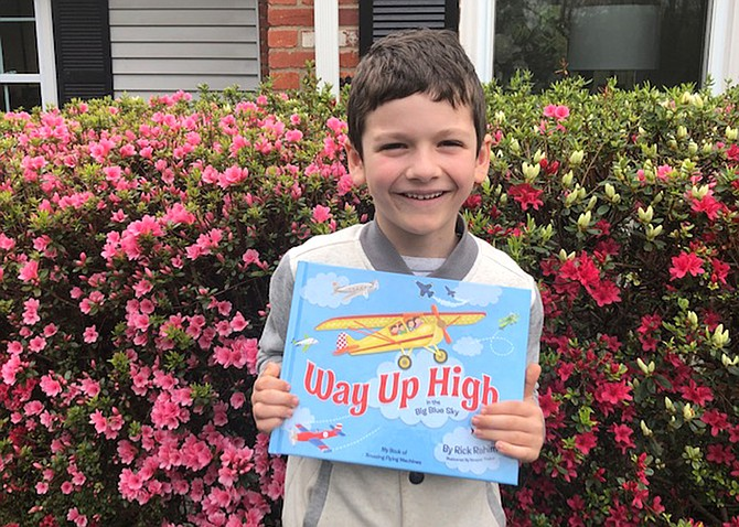 Chaz with gift dropped by off local author, Rick Rahim.