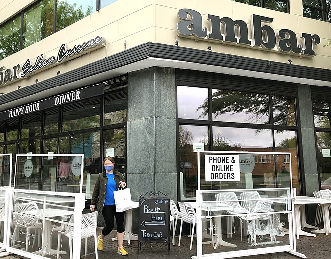 Customer leaving Ambar with carry out.