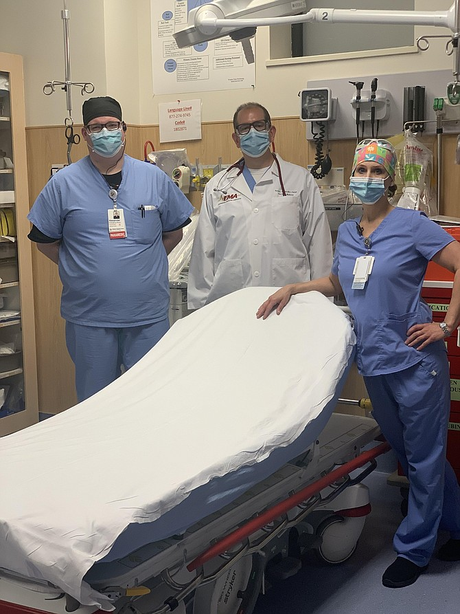 Come to the ER, it's safe. Paramedic Alex Apple and nurse Kelly Duckworth join Chairman and Medical Director of the Department of Emergency Medicine at Reston Hospital Center HCA Virginia Health System, David Jacobs, MD, in an ER room at the hospital.