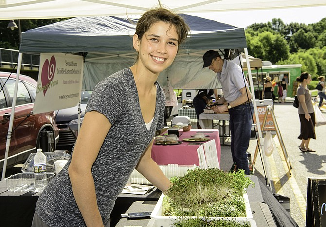Fresh air, fruits and vegetables bring out the smiles at the county's Farmers Markets.