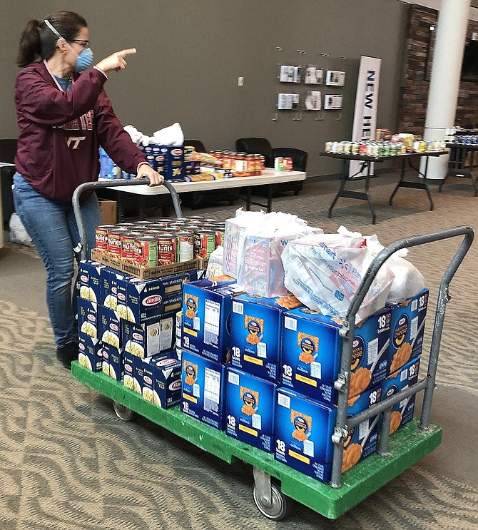 Nicole Martinez at Centreville Baptist Church with food for distribution.