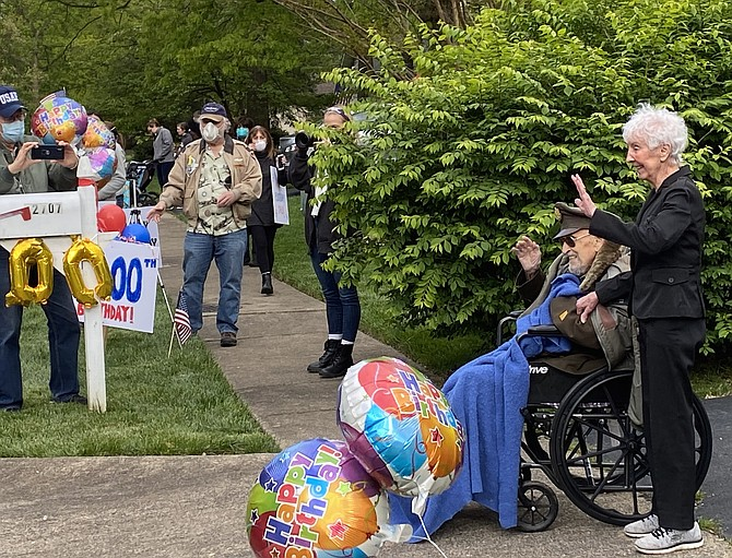 With wife Julia by his side, Herndon resident Air Force Col. Robert A. Shawn (Retired) who turned 100 years old, smiles as more than 120 vehicles join the birthday caravan parade organized by his fellow Post members at Veterans of Foreign Wars Loudoun County Post #1177.